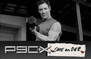 beachbody coach tony horton holding a dumbbell as he coaches you 1 on 1 through the p90x workout offered by the top male beachbody coach scottie hobbs